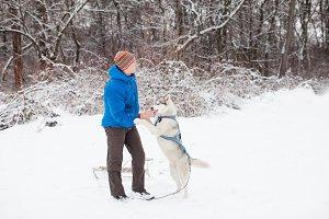 Man with husky dog