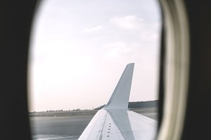 View of plane wing by window.