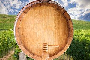 Wine barrel over vineyard