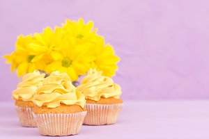 Cupcakes decorated with yellow cream