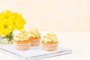 Cupcake with tender yellow cream