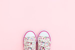 Sneakers for little girl. Copy space
