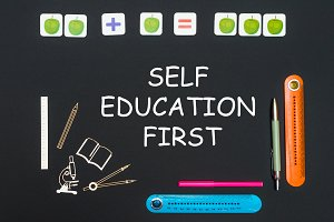 Above stationery supplies and text self education first on blackboard