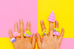 Hands in candy accessories. Minimal