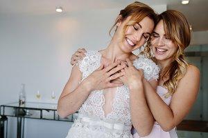 Bridesmaid giving a tender hug