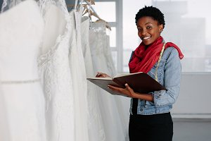 Female bridal wear designer working