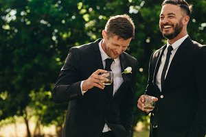Groom and best man drinking