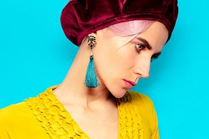 Model in fashion accessory beret and