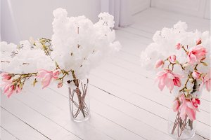 white spring flowers in the vintage interior of the house