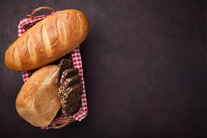Fresh bread on stone table. Top view with space for your text