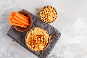 Hummus and fresh carrot sticks