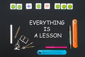 Above stationery supplies and text everything is a lesson on blackboard