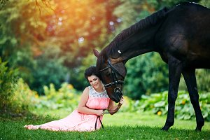 beautiful girl in dress with horse