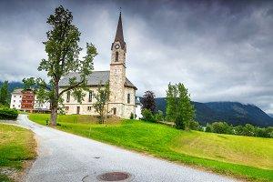 Alpine village with church, Austria
