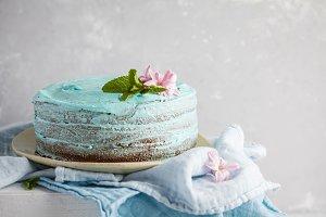 Blue stylish cake with flowers