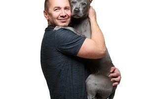 man holding thai ridgeback dog