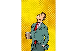 Businessman drinking coffee and looking up
