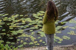 Girl looking at the lake