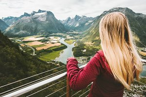 Blonde woman sightseeing mountains