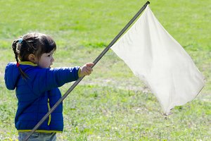 litlle girl with white flag