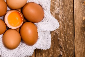 basket with eggs and one broken with