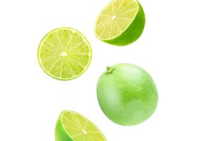 Isolated flying lime fruit wedges