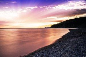 Epic light beams over the ocean landscape backdrop