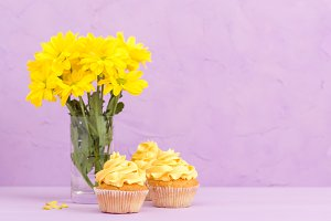 Yellow chrysanthemum and cakes