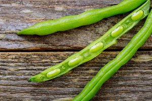 Fresh green beans on old wooden