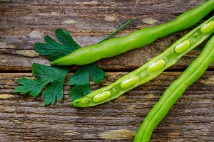 green bean on wooden plank
