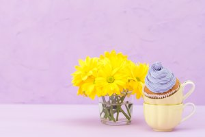 Cupcakes decorated with violet cream