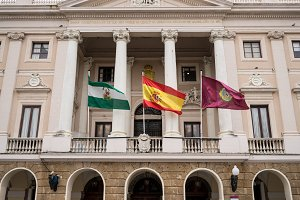 Flags fly on the Town Hall of Cadiz in Southern Spain