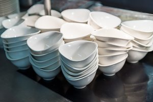 Stack of white china soup or salad bowls