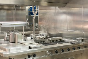 Modern stainless steel hobs in commercial kitchen