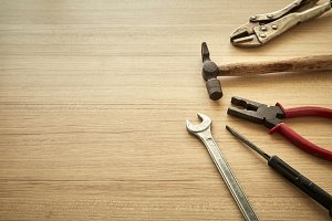 tools supplier on wood backgrounds. Place for your text