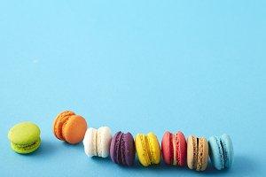 mini macaron or macaroon concept on pastel blue background