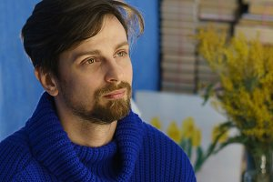 Artist in a blue sweater