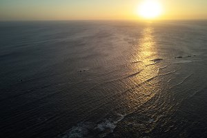 Sunset on ocean aerial view