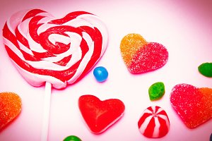 Lollipop in the shape of heart and c
