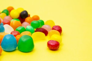 colorful candies on yellow backgroun