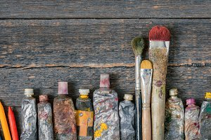 Brushes and tubes with paint