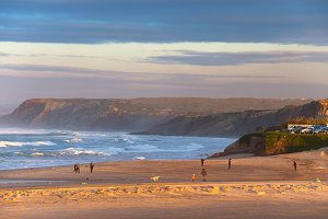 People walking at the ocean beach