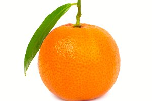 Orange mandarin with green leaf