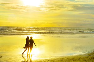 Couple walking on tropical beach
