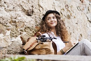 A young tourist with a camera in the old town.