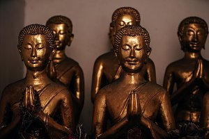 Golden Praying Statues