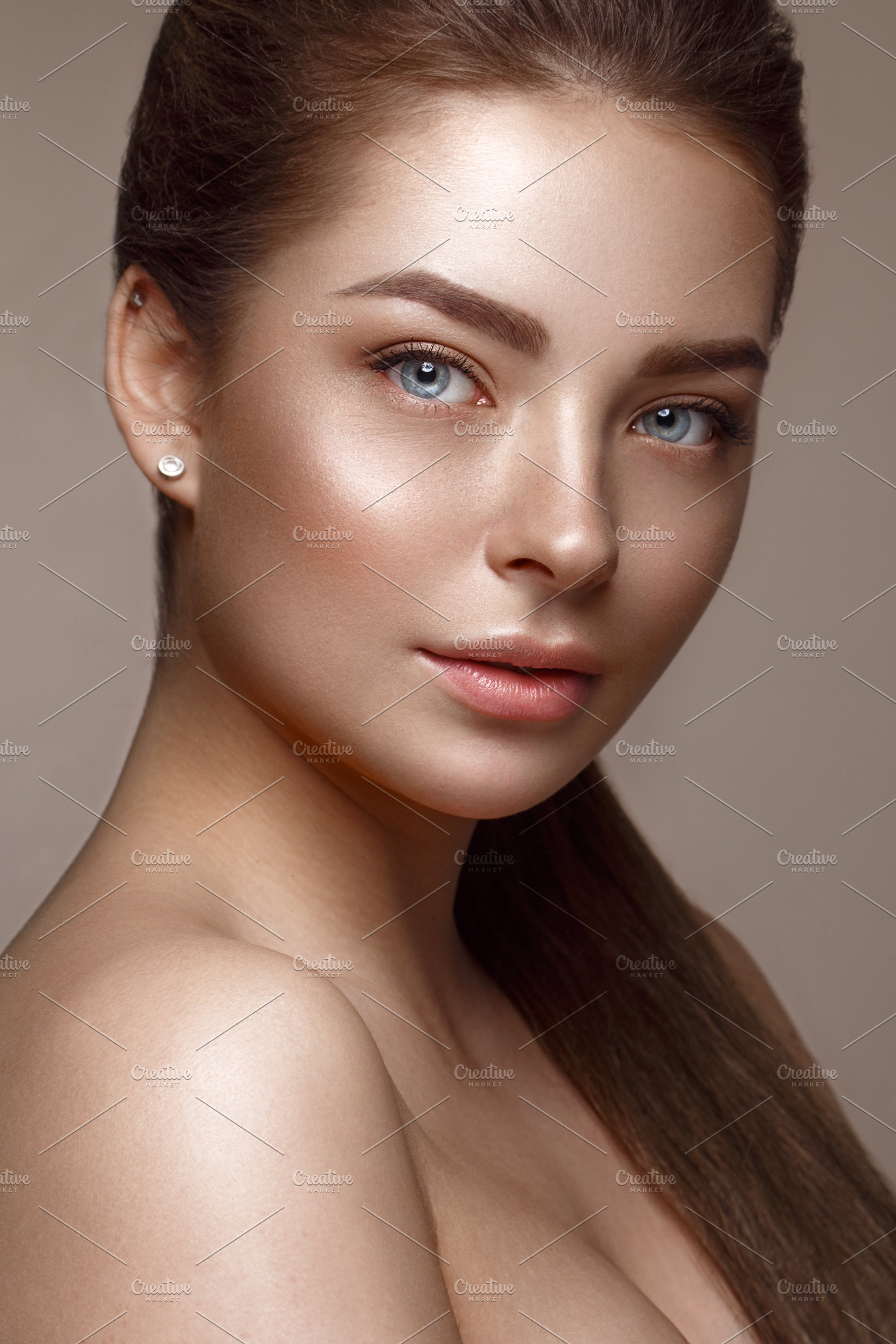 Beautiful young girl with natural nude make-up. Beauty