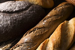 Fresh baked bread background, variety of different kind of breads, food industry