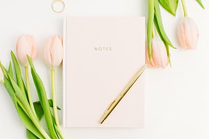 Notebook and tulip flowers