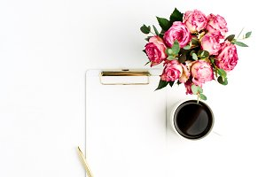 Clipboard and roses bouquet